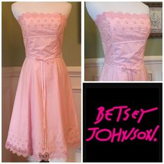 "Betsey Johnson Stunning Pink Dress So Beautiful!!!  Baby Pink color with beautiful scalloped trim across the top and hem. Fully lined, and can be tighten or loosened with the decorative lace draw string tie. Side zip. Measures 30"" from top to hem and 13.5"" under bust area with tie. Excellent condition, worn once. Betsey Johnson Dresses"