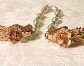Vintage Sweater Guards Rose Leaves Pearl Chain  http://www.etsy.com/shop/RosePetalResources?ref=si_shop