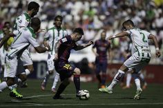 Lionel Messi (2ndR) of FC Barcelona competes for the ball with Aleksandar Pantic (R) of Cordoba CF during the La Liga match between Cordoba CF and Barcelona FC at El Arcangel stadium on May 2, 2015 in Cordoba, Spain.