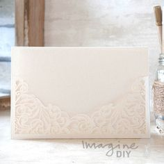 Filigree Laser Cut Pocket Range in Pearlised Ivory  Laser cut wedding invitations perfect for your luxury wedding. DIY laser cuts are easy and elegant with options to insert your own printer inserts.