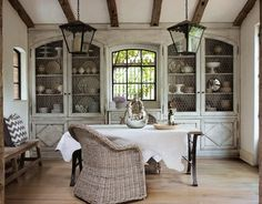 exposed beams  grey washed cabinets w/ chicken wire