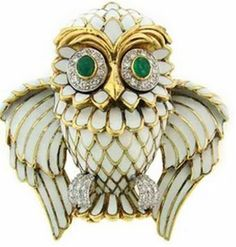 Owl of white enamel, diamonds, gold and emeralds. Donald Claflin design, New York.