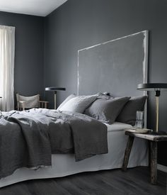 No instructions for DIY, but bet it would be easy to create the headboard with a huge artist canvas or wood board and tack it to the wall behind the bed. Dark walls and a mix of chairs - via cocolapinedesign.com