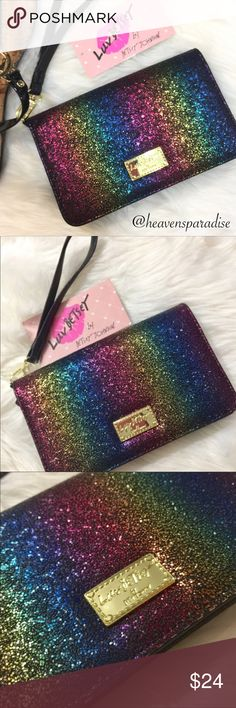 """Betsey Johnson rainbow ombré wristlet This stunning Luv Betsey by Betsey Johnson rainbow ombré wristlet has the perfect amount of bling and is perfect for a fun night out!! The pictures do not do it justice. Trust me you will love it. Has a magnetic closure with black and white print lining. Inside it has slots for cards, ID, and room for a cellphone, lip gloss, makeup, etc. It measures approximately 7""""W x 4 1/4""""H x 1 1/2D (at is widest part) The wrist strap has a 6"""" drop and is detachable…"""