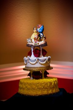 beauty and the beast wedding cake inspired by belles dress  topper from Disney land