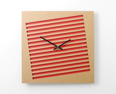 Design by Brandon Perhacs, square laser-cut clocks from recycled and renewable material
