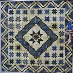 COUNTRY LOG CABIN: QUILT SHOW Quilt is Log Cabin mixes with star blocks and pieced border.