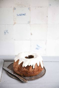 apple poppy seed bundt cake with sour cream icing.