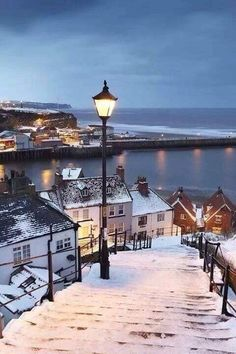 Whitby covered by snow, North Yorkshire, England. Born in England 1950 left in 1962 must return one day. Yorkshire England, North Yorkshire, Yorkshire Dales, Oh The Places You'll Go, Places To Visit, Winter Scenery, Winter Sunset, London England, Honeymoons