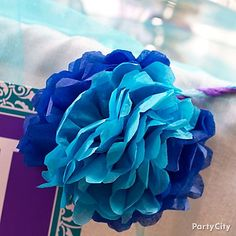 The perfect paper flowers for a blue and purple wedding or bridal shower. Click for more from this gorgeous candy buffet ideas gallery and a link to our easy paper flowers how-to page.