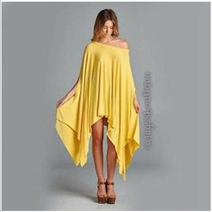 🌟2 LEFT🌟Yellow Tunic Poncho 🇺🇸SALE🇺🇸Yellow ultra-soft and flowing, loose fit poncho tunic. Can be worn as a tunic top or a dress. Asymmetrical hemline. Edgy and sophisticated yet comfy. Great as a beach cover up too. 95% Rayon 5% Spandex. Made in USA. ONE SIZE FITS SMALL-XXXL Tops Tunics