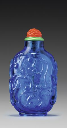 A PEACOCK-BLUE GLASS 'CHILONG' SNUFF BOTTLE QING DYNASTY, QIANLONG / JIAQING PERIOD