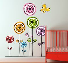 #Wallsticker -  #Colourful and playful #design of #flowers ideal for decorating a boring white wall. #tenstickers