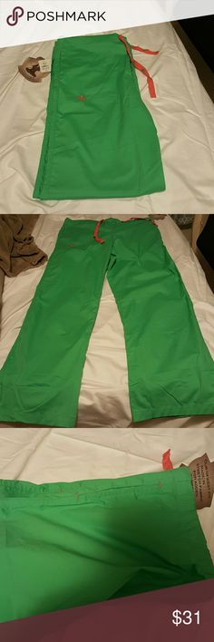 Med Couture scrub pants large tall, green, pink Brand new with tags.  Given to me as a gift earlier this year but they don't fit me.  Beautiful color!  Drawstring pants. Side pockets towards the hip,  as shown in the third picture.  The tag says it's the newest fit for added comfort.  3% spandex. Slightly lighter color green than the pic is able to show.  Just slightly. med couture Pants