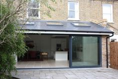 Take a look at our kitchen extension and side return gallery. View our variety of Extensions in the capital. Request a Free Quote online. Kitchen Extension Pitched Roof, Kitchen Extension Exterior, Kitchen Extension Side Return, House Extension Plans, Kitchen Diner Extension, House Extension Design, Roof Extension, Extension Ideas, Bungalow Extensions