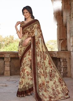 Idyllic Georgette Colour Brown Printed Saree  https://www.gnoutlet.com/collections/sarees/products/thriving-pink-colour-net-embroidery-anarkali-suit