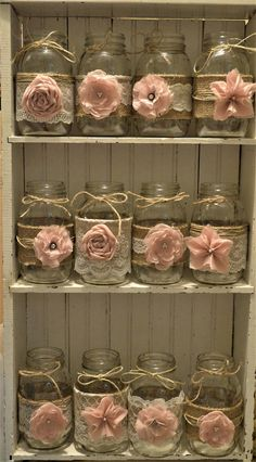12 handmade mason jar sleeves. Perfect for a rustic wedding or a baby shower. Burlap adorned with lace and handmade light pink flowers. Please note that mason jars are not included. These are made to fit your Ball quart sleeves. This is to save you on shipping charges. Fits Ball