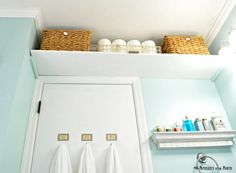 Love the idea of over the door and over the towel rack shelves