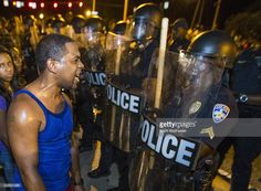 Protesters face off with Baton Rouge police in riot gear across the street from the police department on July 8, 2016 in Baton Rouge, Louisiana. Alton Sterling was shot by a police officer in front of the Triple S Food Mart in Baton Rouge on July 5th, leading the Department of Justice to open a civil rights investigation.