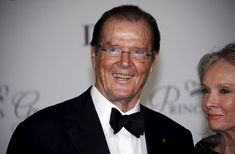British actor Roger Moore and his wife Kristina Tholstrup arrive at the Princess Grace Awards gala in Monaco