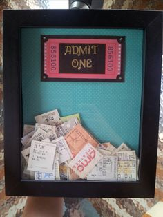 "Movie ticket shadow box-turquoise paper stock as the background, made the ""Admit One"" and added diamond stickers for flare. (By: Viktorija)"