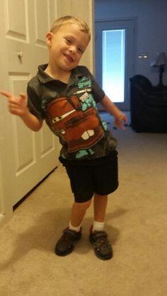Dylan modeling his new Mater shirt that Gigi bought him.