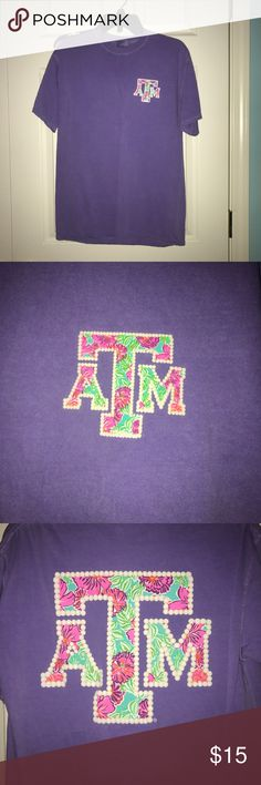 Texas A&M comfort colors shirt Medium purple comfort colors shirt. Floral and Pearl logo. Bought at A&M warehouse in CSTAT. Texas A&M Tops