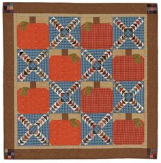 """Feels Like Fall wall hanging, ~48 x 48"""", pattern by Avis Shirer at American Patchwork & Quilting.  Flying Geese and pieced pumpkins."""