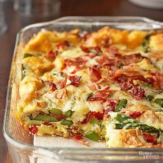 Layers of crispy bacon, asparagus, and red pepper come together with eggs, Swiss cheese, bread cubes, and seasoning to make this flavorful strata! http://www.bhg.com/holidays/easter/recipes/an-easter-brunch-that-dazzles/?socsrc=bhgpin032015baconasparagusstrata&page=11