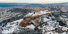 Bet'cha never thought you'd see snow in Greece, did you? Well think again. In the photos below, you can see the beautiful Acropolis sitting on its mountaint