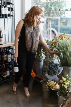 Never arrive empty handed! I like to bring a bottle of bubbly and some blooms when attending a holiday brunch. Pairing a lace jumpsuit @nordstrom with a fur stole and fun heels is the perfect cozy and chic ensemble, while sticking to my holiday budget.