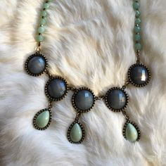 Beautiful Bohemian Necklace Brand new, never worn. Beautiful design, great for spring. Gray and light green faux stones set in a bronze tone setting. World Market Jewelry Necklaces