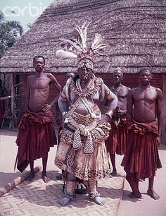 Africa | The King of the Kuba, accompanied by several men from his tribe, wears an elaborate white ceremonial outfit. Belgian Congo (now DR Congo). ca. 1950 | © Otto Lang