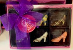 A fanciful display of posh mini chocolate shoes from Zoe's Chocolate Couture. All boxed up and ready to ship. For ordering information please visit our website at www.zoeschocolate.com or stop in at either location in Frederick or in Waynesboro