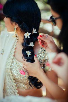Mehendi Hairstyles - Loose Braid with Flowers | WedMeGood #wedmegood #indianbride #indianwedding #hairstyle #engagementhairstyle #floral #bridalhairstyle