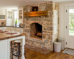 Fabulous kitchens showcasing warm and cozy fireplaces A cozy fireplace in a farmhouse kitchen. The mantle in chestnut matches the island counter top. Kitchen Fireplace, Farmhouse Kitchen Decor, Farmhouse Fireplace, Cottage Fireplace, Cozy Fireplace, House, Primitive Kitchen, Interior Design Kitchen, Rock Fireplaces
