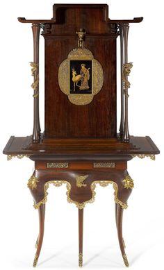 *Un cabinet « japonisant » de l'ébéniste et ornementiste français Édouard Lièvre (1829-1866). Ce cabinet en bois de rose et laque reprend avec fantaisie la forme d'une pagode extrême-orientale, enrichie de bronzes, des dragons s'entortillant autour des colonnettes et des têtes de lion ornant le piètement.