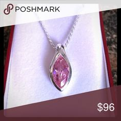 "STERLING SILVER PINK ICE PENDANT NIB Spectacular! This pendant is .925 solid sterling silver. It is a heavy finely finished setting, holding a marquis cut large pink ice. This stone sparkles like a diamond. Comes on a .925 solid sterling silver rope chain. This chain has a lobster safety clasp. The pendant measures just over 1"". Unique! Gist boxed. NIB Jewelry Necklaces"