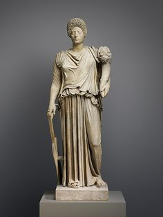 Marble statue of Tyche-Fortuna restored with the portrait head of a woman Period: Imperial, Late Flavian or Early Trajanic Date: 1st or 2nd century A.D. Culture: Roman