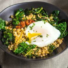 Tender farro, sautéed kale, and a perfectly poached egg. If that's not a good breakfast, we don't know what is. Perfect for Mother's Day.