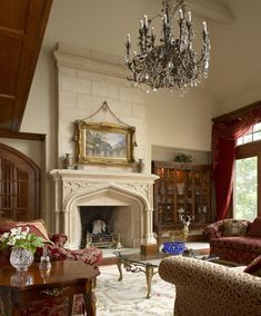 The focus of the great room in this French style chateau is a Gothic stone fireplace. The robust colors and pattern of the fabrics hold their own in this voluminous  regal room. Library case: Baker Stately Homes Collection.  Photo by Beth Singer. Schaerer Architextural Interiors Robert Schaerer - Bloomfield Hills, MI