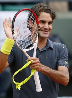 Switzerland's Roger Federer reacts after winning over Argentina's Juan Martin Del Potro during their Men's Singles Quaterfinals tennis match of the French Open tennis tournament at the Roland Garros stadium, on June 5, 2012 in Paris.