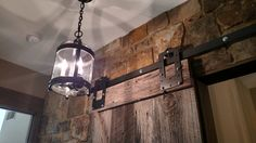 Awesome barn door with glass pendant light.