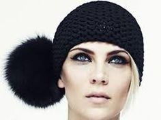 fur or fake-fur pom-pom on a hat