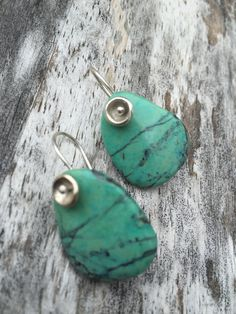 These brilliant turquoise colored Chrysocolla stones have a lovely pebble shape. There is a tiny dapped & oxidised saucer at the top of the stone. They measure 1 1/4 long X 3/4 wide.