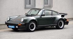 Take, for example, the dark green paintwork and tobacco-coloured leather interior worn by this archetypal sports car of the late 70s, a Porsche 911 Turbo. Description from classicdriver.com. I searched for this on bing.com/images
