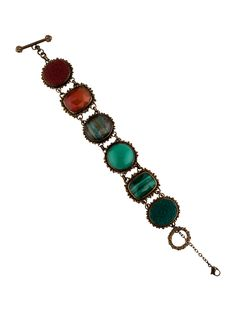 $305.00   Textured brass Stephen Dweck charm bracelet with quartz doublet, chrysoprase, malachite and floral carved carnelian stones and toggle closure.