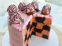 Strawberry and chocolate cake - this is dark chocolate and strawberry checkerboard cake.. decorated w/ strawberries piped w/ melted chocolate