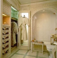 Lots of storage in Howard Slatkin guest bathroom, with built in drawers, hanging space and shelves.  Floor is hand-painted.