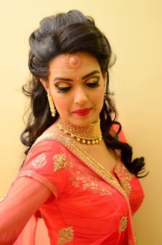 Aparna for reception. Makeup and hairstyle by Vejetha for Swank Studio. Glitter eye makeup. Coral lips. Maang tikka. Bridal jewelry. Bridal hairi. Bridal lehenga. Indian Bridal Makeup. Indian Bride. Gold Jewellery. Statement necklace. Tamil bride. Telugu bride. Kannada bride. Hindu bride. Malayalee bride. Find us at https://www.facebook.com/SwankStudioBangalore